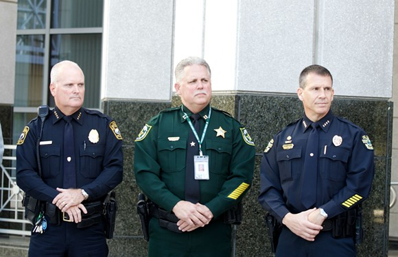 Law enforcement officials from Orlando Police Department, Apopka Police Department and the Orange County Sheriff's Office. - PHOTO BY MONIVETTE CORDEIRO
