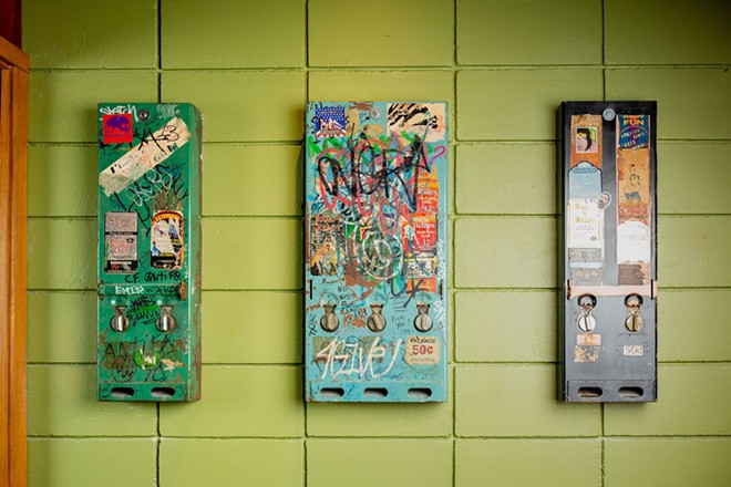 Matchbook condom dispensers guised as art - DAVID LAWRENCE