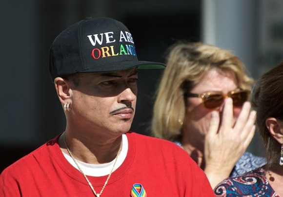 Orlando Torres, survivor of the massacre and promoter at Pulse, listens to other survivors. - PHOTO BY MONIVETTE CORDEIRO