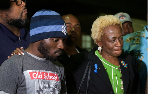Master Sgt. Debra Clayton's son and Orlando City Commissioner Regina Hill speak at the vigil in honor of the fallen Orlando Police officer. - PHOTO BY MONIVETTE CORDEIRO