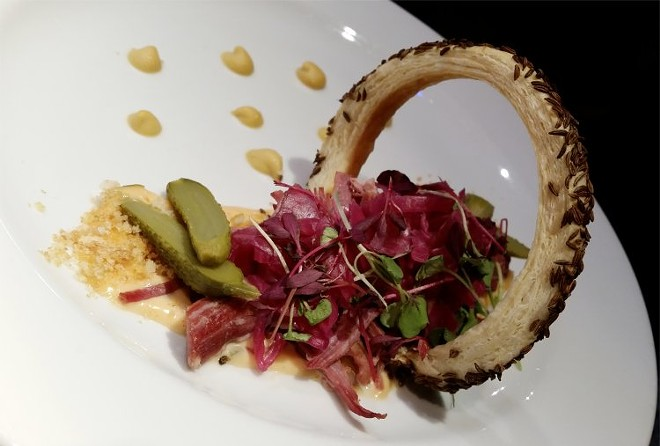 Deconstructed Reuben, shredded corned beef, Thousand Island dressing, pickled red cabbage, rye curl