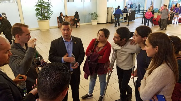 3:15 p.m.: Rep. Soto delivers hopeful news to the friends and family members waiting. - DAVE PLOTKIN