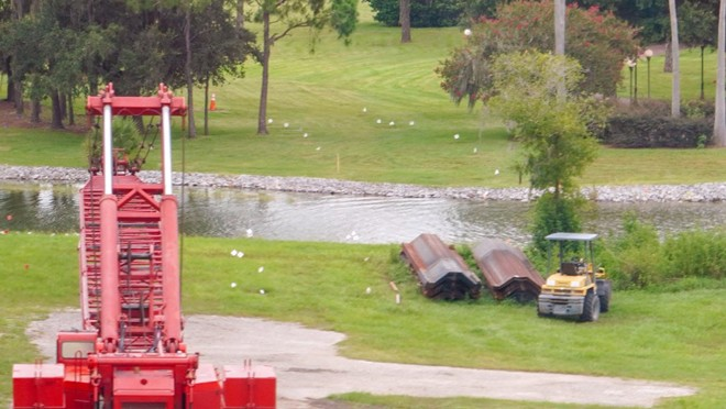 White flags and steel retaining walls are seen on the site of where the new Grand Floridian to Magic Kingdom pathway will be located. - IMAGE VIA BIORECONSTRUCT | TWITTER
