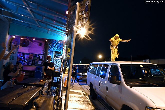 Peelander-Yellow on top of a van, hopefully his - JEN CRAY