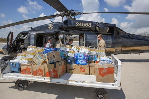 CBP AMO agents deliver food and water to Fox Town on the Abaco Islands in the Bahamas, Sept. 6 2019. - CBP PHOTO BY KRIS GROAGN VIA WIKIMEDIA COMMONS