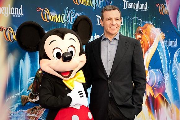 Disney CEO Bob Iger with a Disney employee in costume - PHOTO VIA WIKIMEDIA