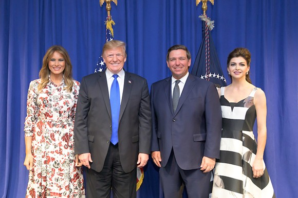 PHOTO OF MELANIA AND DONALD TRUMP WITH RON AND CASEY DESANTIS VIA WIKIMEDIA COMMONS