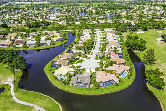 BOCA RATON GATED COMMUNITY PHOTO VIA ADOBE STOCK
