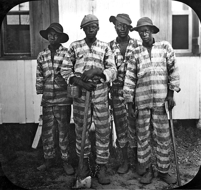 """Convicted Black men """"leased"""" to harvest timber around 1915 - PHOTO VIA """"LYNCHING IN AMERICA""""/STATE ARCHIVES OF FLORIDA"""