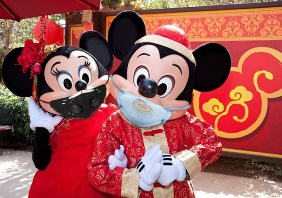 An altered image of Disneyland's Lunar New Year Mickey and Minnie going viral on social media. - IMAGE VIA ZANE/@FUGGINSPAM/TWITTER