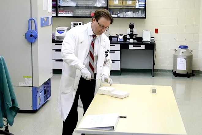 Todd Roberts with his invention - SCREENSHOT VIA ORLANDO HEALTH/YOUTUBE