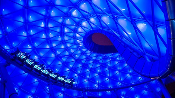 A Tron coaster car in the outside portion of the ride under the roof strutcture at Shanghai Disneyland - IMAGE VIA DISNEY