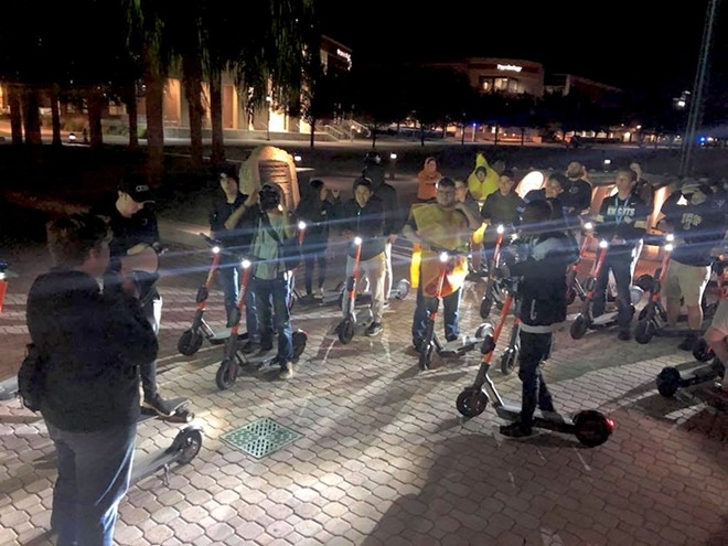 "Dozens of UCF students gather every Friday night at 9 p.m. to ride around campus as ""Spin Squad,"" a social group that formed recently due to the new scooters on campus. - LILLIAN M. HERNÁNDEZ CARABALLO"