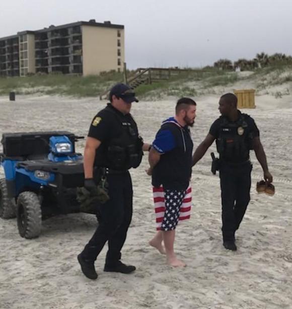 Two Jacksonville Beach Police officers arrest Mario Matthew Gatti on Saturday - PHOTO VIA JAXBEACHPD/TWITTER