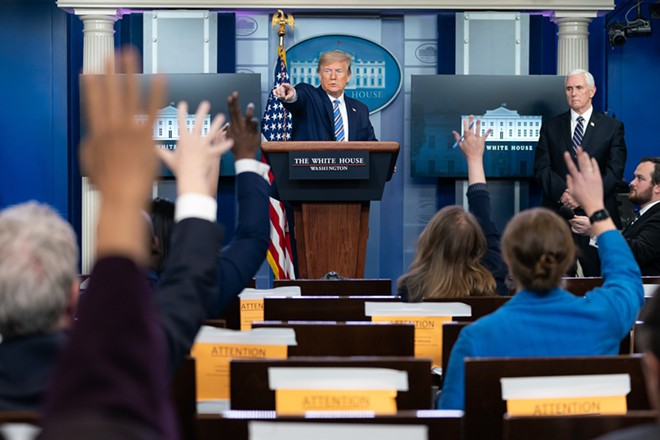 The bloody hand points. - PHOTO BY TIA DUFOUR FOR THE WHITE HOUSE