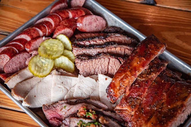 4 Rivers Smokehouse is serving platters of ribs, sliced brisket, pulled pork and smoked sausage. - PHOTO VIA 4 RIVERS SMOKEHOUSE/FACEBOOK