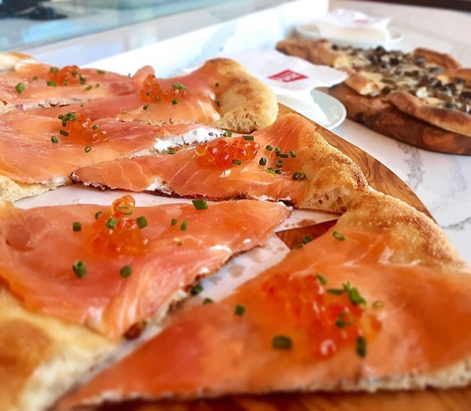 Smoked Salmon pizza with dill cream, chives and salmon pearls - PHOTO VIA WOLFGANG PUCK BAR & GRILL ORLANDO/FACEBOOK