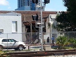 A photo of the building after today's explosion shows that the side of the building was torn open. Photo by Dave Plotkin.