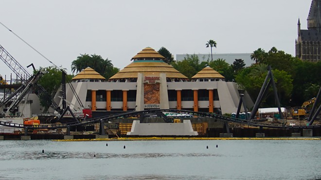 The Discovery Center with the new coaster being installed in front of it. As seen from the Port of Entry. - IMAGE VIA BIORECONSTRUCT   TWITTER