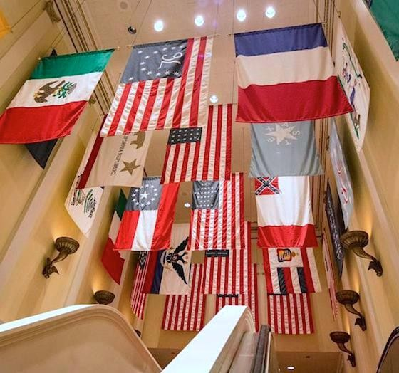 The Hall of Flags with the now-removed last official flag of the Confederate States of America (center-right). - PHOTO VIA THEME PARK INSIDER