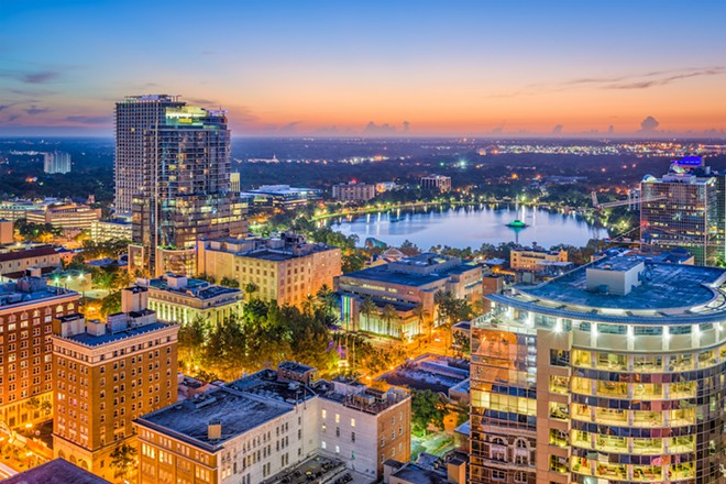 Downtown Orlando at night - PHOTO VIA ADOBE STOCK
