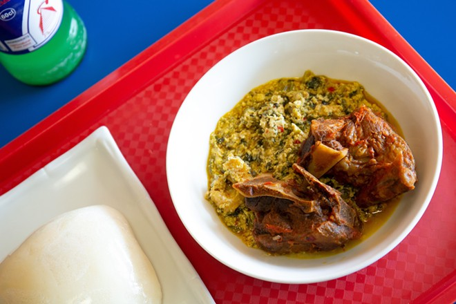 Egusi (goat pepper soup) with pounded yam - PHOTO BY ROB BARTLETT