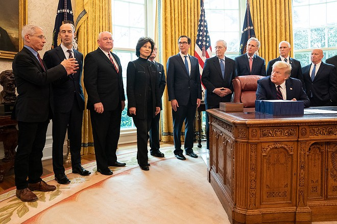 President Donald Trump signing the CARES Act in March - OFFICIAL WHITE HOUSE PHOTO BY SHEALAH CRAIGHEAD