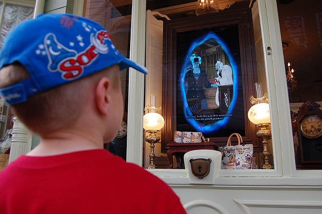 Game portals, like this one on Main Street, were designed to blend in with their land. - IMAGE VIA DISNEY