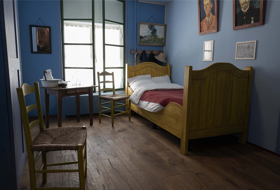 A recreation of the Arles Bedroom from the Van Gogh painting in the Hotel Riche. At the close of WWII, the original  bed from Arles was donated to Boxmeer, by the Van Gogh family, to be used by local residents displaced by the war. Boxmeer, The Netherlands. - PHOTOGRAPH BY PATRICIA LANZA