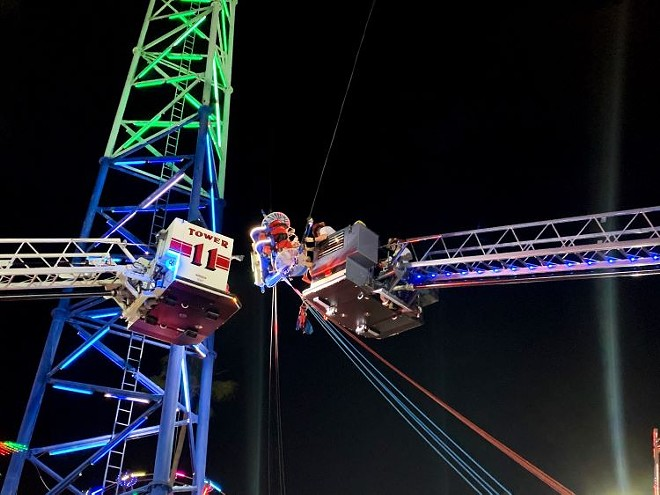 Two teenagers were rescued from a malfunctioning ride at Old Town USA in Kissimmee. - PHOTO VIA FACEBOOK/OSCEOLA COUNTY FIRE RESCUE AND EMS