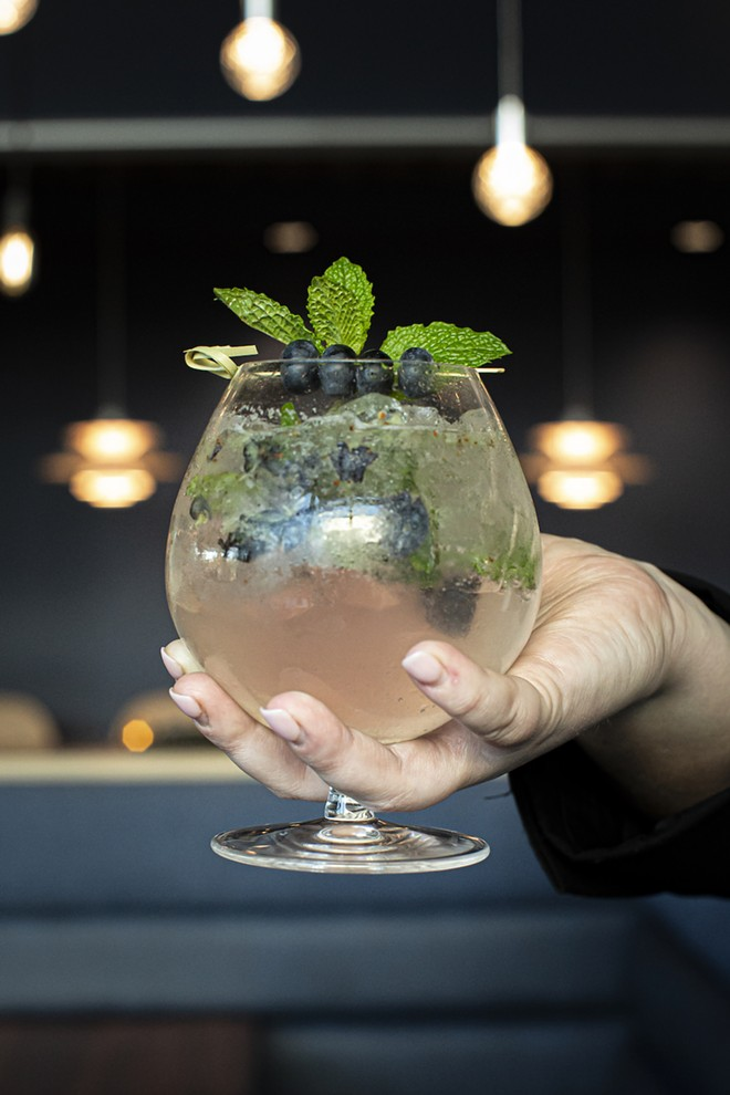 Zodiac mocktail with muddled blueberries and mint - PHOTO BY ROB BARTLETT