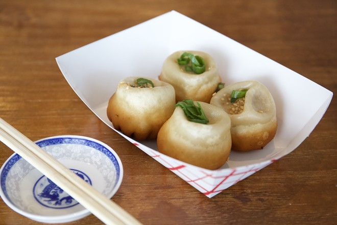 Sheng jian bao (pan-fried pork bun) - PHOTO BY ROB BARTLETT