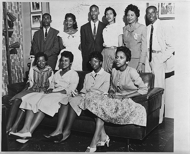 The Little Rock Nine pose for a photo. Minnijean Brown Trickey is the second person on the left on the bottom row. - PHOTO VIA CHICAGO TONIGHT