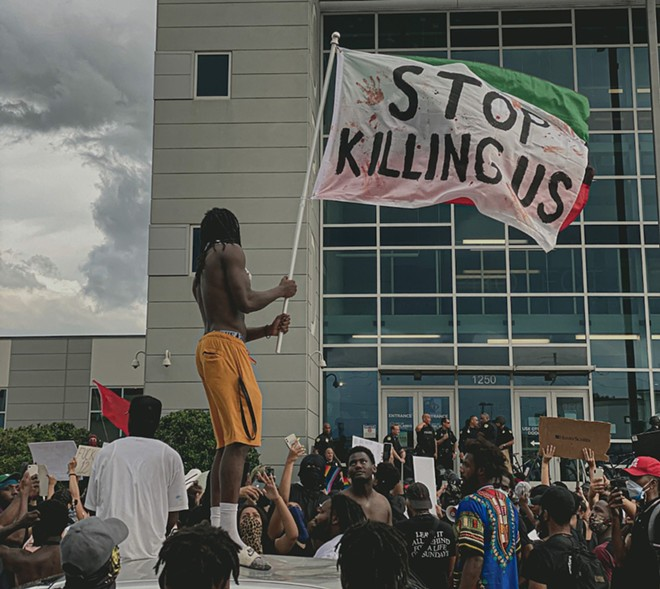 Protesters gathered outside the Orlando Police Department last summer. - PHOTO BY NICOLAS TAMAYO LEON