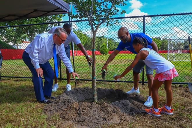 Orlando Mayor Buddy Dyer and District 6 City Commissioner Bakari F. Burns at the inauguration of Grand Avenue Park. - VIA CITY OF ORLANDO
