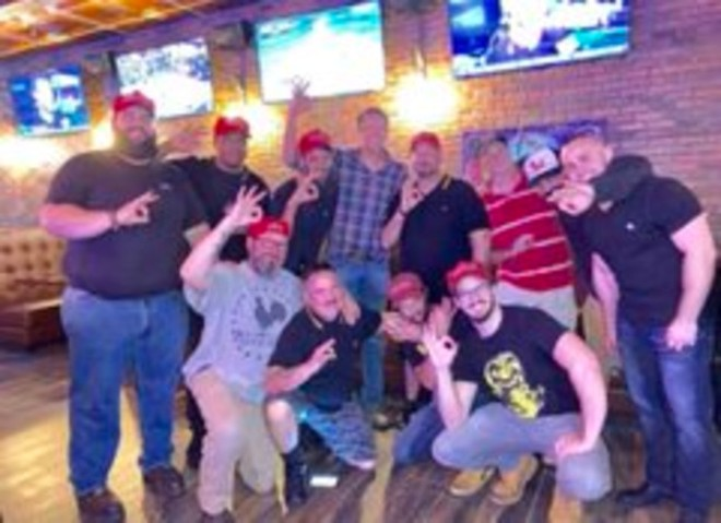 Nathanial Tuck, pictured on the far right of the photo in the black shirt, at the Proud Boy meet-up in Orlando. - PHOTO OBTAINED BY CREATIVE LOAFING TAMPA BAY