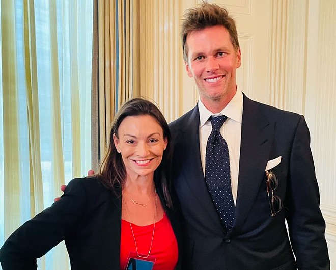 Florida's only statewide elected Democrat is facing criticism for posing with Tom Brady. - PHOTO VIA NIKKI FRIED/TWITTER