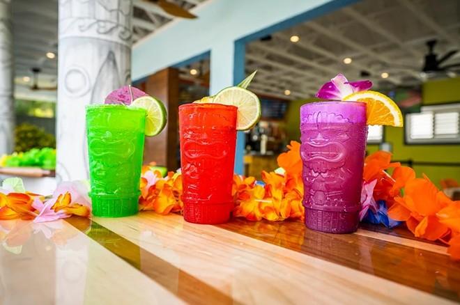 Some of the tiki-inspired mugs available at the Hang Ten Tiki Bar - IMAGE VIA ADVENTURE ISLAND