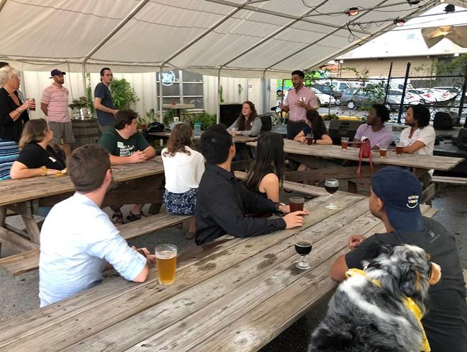 The Orlando YIMBY group meet-up at Orlando Brewing - IMAGE VIA AUSTIN VALLE