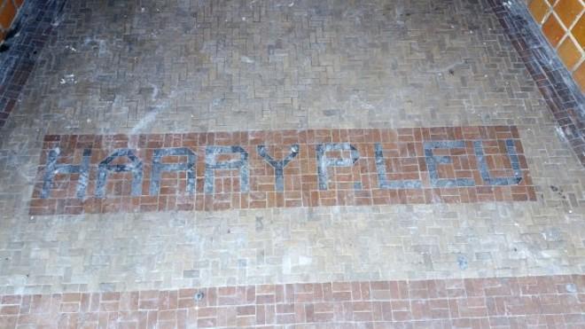 """Tiled entrance on W. Livingston St. reading """"Harry P. Leu"""""""