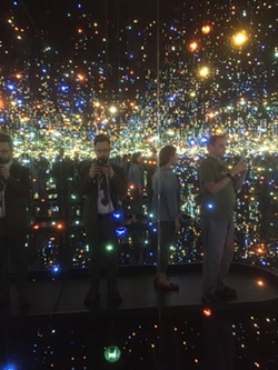 The author in Yayoi Kusama's installation 'The Souls of Millions of Light Years Away'