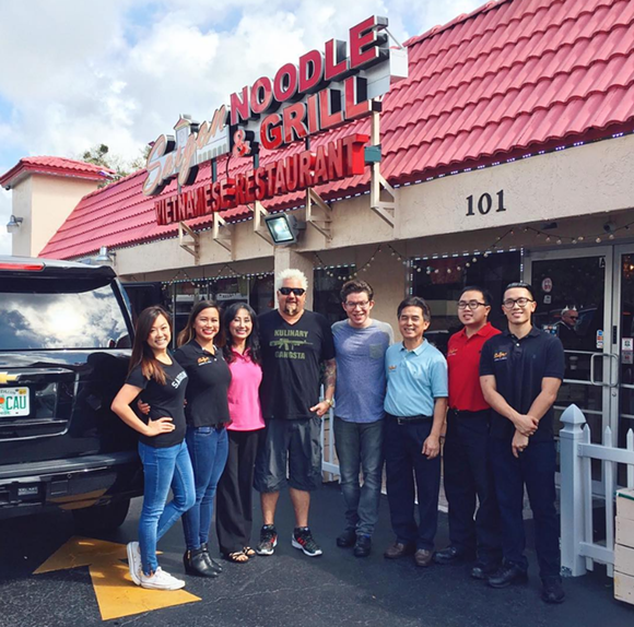 The Nguyen family, owners of Saigon Noodle & Grill, poses for a pic with Fieri after taping the show. - PHOTO COURTESY @SAIGONNOODLEANDGRILL ON INSTAGRAM
