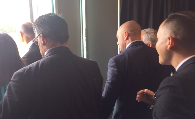 Here's Scott (far left, bald) allegedly running away from Smith (far right) - PHOTO VIA CARLOS GUILLERMO SMITH/TWITTER