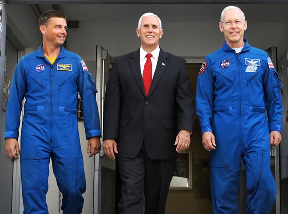 Mike Pence leaves a tour of Orion facilities at O&C High Bay with NASA astronauts Reid Wiseman (left) and Pat Forrester (right). - JOEY ROULETTE FOR ORLANDO WEEKLY