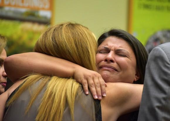 Jessica Realin hugs Pulse owner Barbara Poma. - PHOTO BY MONIVETTE CORDEIRO