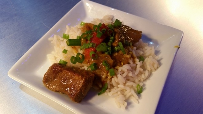 Red hot spicy Thai curry beef with steamed rice (Thailand)