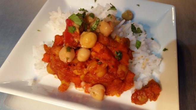 Madras red curry with roasted cauliflower, baby carrots, chickpeas, and basmati rice (India)