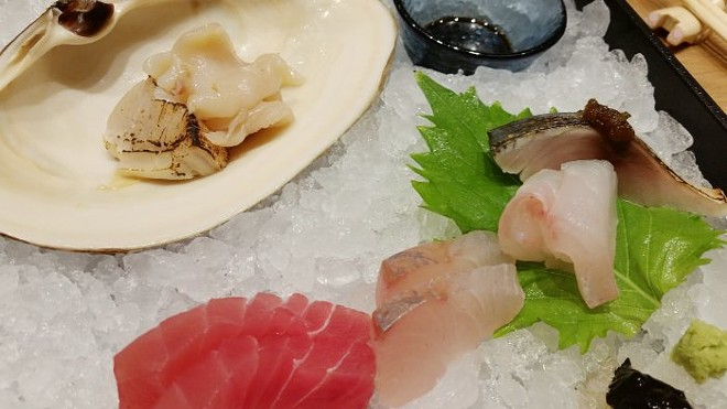 Sashimi (clockwise from top left): Aoyagi (orange clam), saba (Japanese mackerel), hata (Japanese grouper), baby kanpachi, aged bigeye tuna