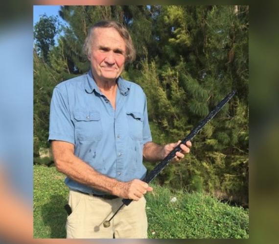 Gary Bachmann with the recovered sword - PHOTO VIA MY PALM BEACH POST