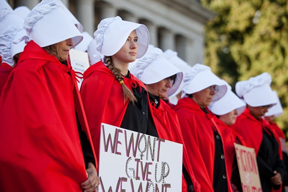 A scene from the 50 Handmaids in 50 States protest in Olympia, Washington - IMAGE VIA CROSSCUT